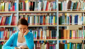 girl-studying-in-library-1